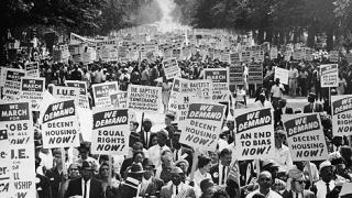 Advocates for racial and social equality march in Wasington D.C. (photo by Getty Images)