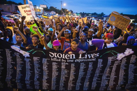 Protesters in Ferguson, Missouri, hold large banner containing the many names of individuals known to have been killed in confrontations with police. (Photo: Reuters)